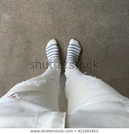 childs feet on striped rug stock photo © is2