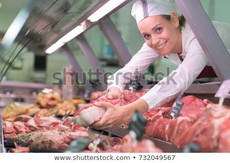 Female butcher processing sausages Stock photo © wavebreak_media