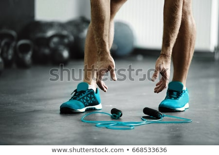 Young sporty man with jumping rope Stock photo © dashapetrenko
