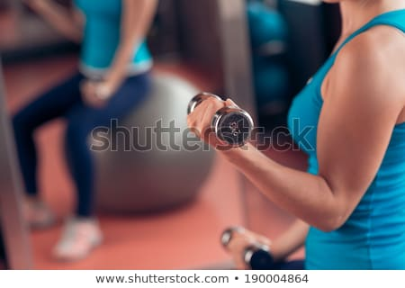 mirror pilates gym woman stability ball sport gym stock photo © lunamarina