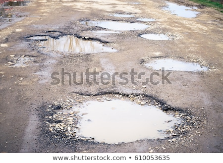Large puddle on a dirty road Stock photo © Nobilior
