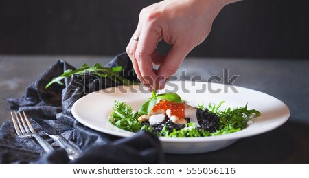 Risotto served on white table Stock photo © georgemuresan
