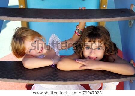 Gyerekek lány néz csúszda lépcsőfeljáró tavasz Stock fotó © lunamarina