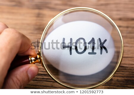 Person Examining 401k White Egg Stock photo © AndreyPopov
