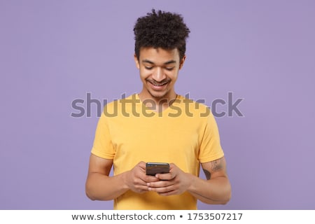 Portrait of a smiling young afro american man Stock photo © deandrobot