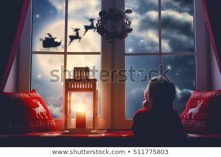 Portrait of a cute little girl looking at the night moon Stock photo © konradbak