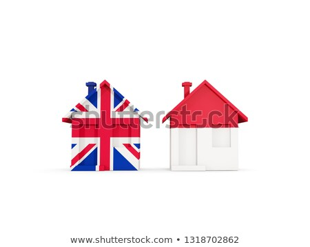 Two houses with flags of United Kingdom and indonesia Stock photo © MikhailMishchenko