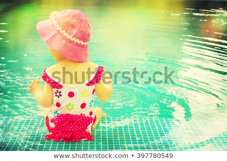 Boy and Girl Playing in Pool Stock photo © 2tun