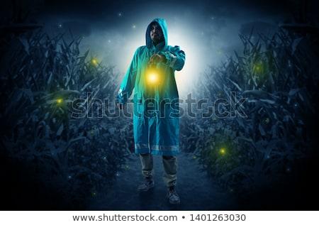 Man uit lantaarn regenjas nacht naar Stockfoto © ra2studio