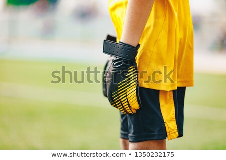 Close up of Soccer Gloves of Young Boy Soccer Goalie Standing in a Goal stock photo © matimix
