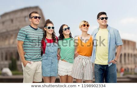happy friends hugging over coliseum background Stock photo © dolgachov