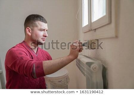 painter on construction site painting wall yellow stock photo © kzenon