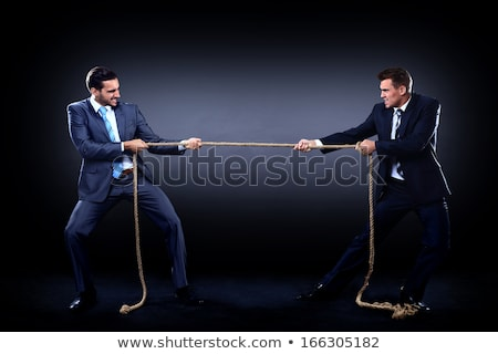 Competition concept with tug of war concept Stock photo © Elnur