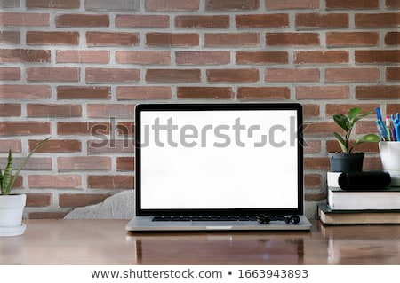Home office workplace with stack of old books Stock photo © karandaev