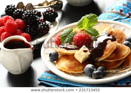Dutch mini pancakes called poffertjes with berries Stock photo © Melnyk