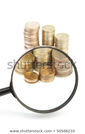 Magnifying glass and lots of gold coins Stock photo © rufous