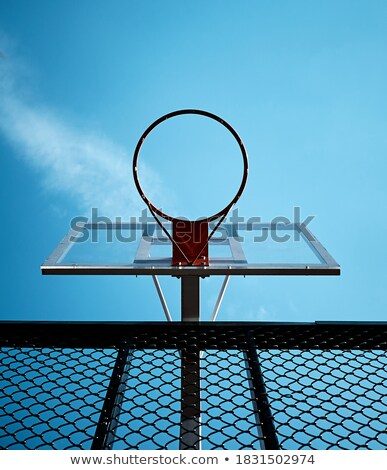 Ball in basketball net with light blue cloudless sky on background Stock photo © pressmaster