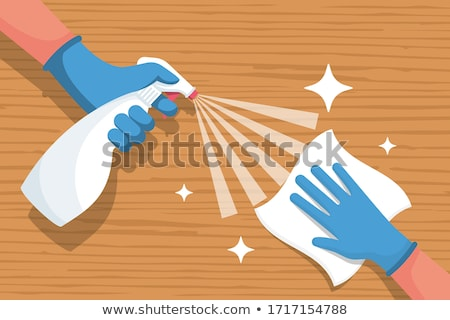 Janitor Cleaning Desk With Napkin Stock photo © AndreyPopov