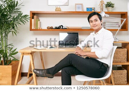 Portrait of businessman in office chair Stock photo © lichtmeister