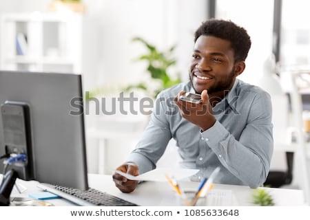 businessman using voice command on smartphone stock photo © dolgachov