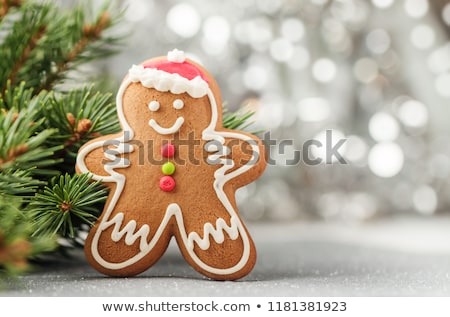 Karácsonyi üdvözlet mézeskalács sütik fenyőfa ág fedett Stock fotó © karandaev