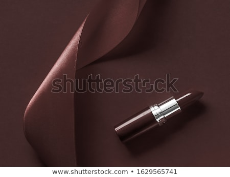 luxury lipstick and silk ribbon on chocolate holiday background stock photo © anneleven