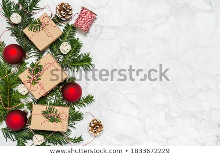 Christmas decorations, pine cones and packed giftbox with conifer on top Stock photo © pressmaster