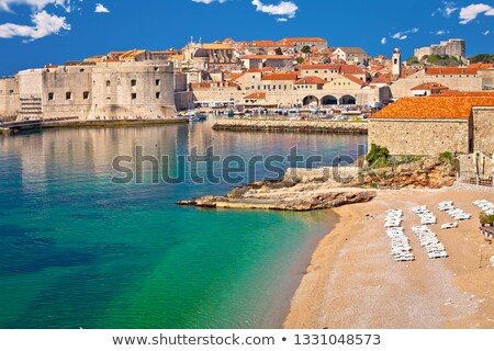 Dubrovnik. Banje beach and historic walls of Dubrovnik view Stock photo © xbrchx
