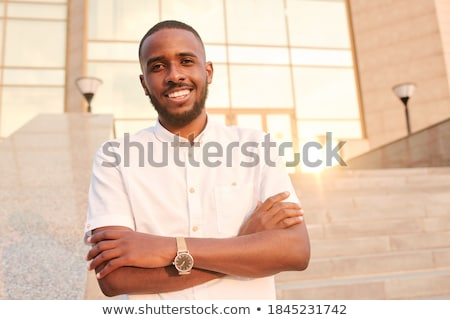 Young confident businessman with crossed arms on chest and toothy smile Stock photo © pressmaster