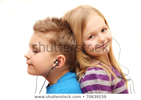 Little girl listen music with a MP3 player, isolated on black Stock photo © Lopolo