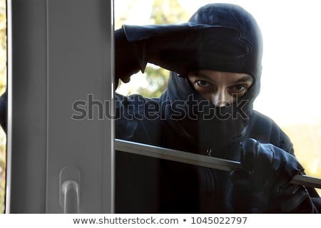 Burglar Looking Into A House Window Stock photo © AndreyPopov