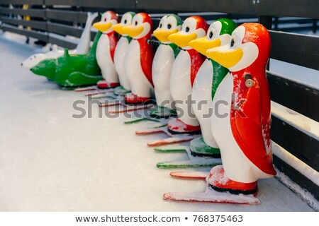 Colorful penguin figures used by skater beginners not to fall on ice covered with snow, Special equi Stock photo © vkstudio