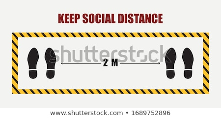 Social distancing concept with person in protective red suit Stock photo © georgemuresan