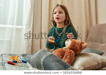 Young girl playing at being a medical doctor Stock photo © Giulio_Fornasar