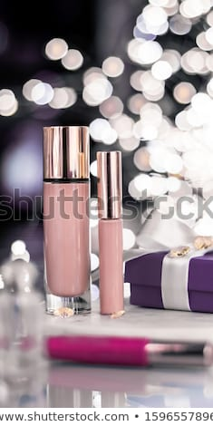 Holiday make-up foundation base, concealer and purple gift box,  Stock photo © Anneleven