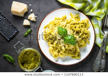 Pasta tagliatelle with pesto sauce and basil Stock photo © Melnyk