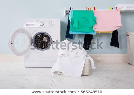 Kadın çamaşır makinesi cihaz bez kız kadın Stok fotoğraf © AndreyPopov