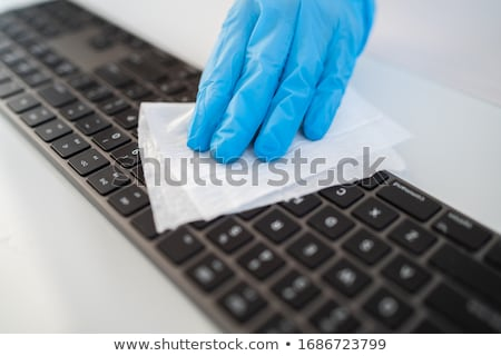 Corona virus cleaning and disinfection of your workspace. Disinfecting wipes to wipe surface of desk Stock photo © Maridav