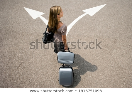 empresária · caminhada · isolado · falante · telefone · móvel · jovem - foto stock © sapegina