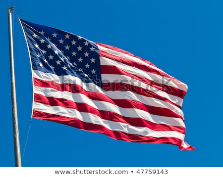Stockfoto: American Flag Waving Proudly On A Clear Windy Day