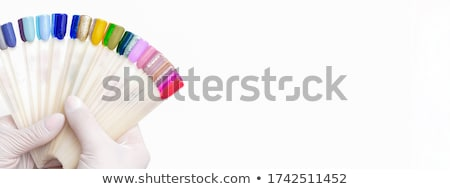 Woman chooses the nail lacquer from collection Stock photo © pekour