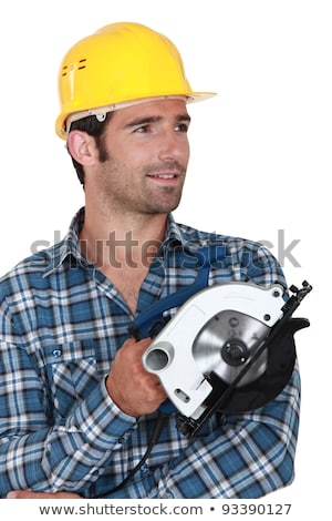 carpenter stood holding circular saw stock photo © photography33