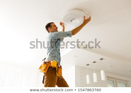 electrician holding replacement bulbs stock photo © photography33