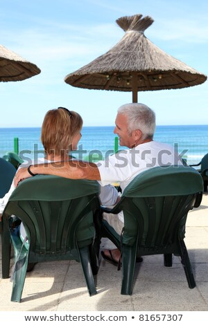 Middle-aged couple sat by the seafront Stock photo © photography33