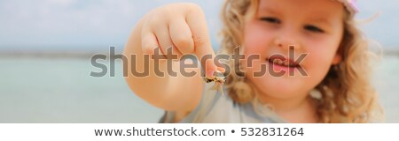 Cute little girl playing at the beach in a rock pool Stock photo © danienel