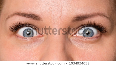 Stock photo: Girl with eyes wide open.