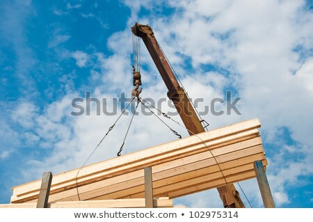 A crane lifting a wood structure. Stock photo © photography33