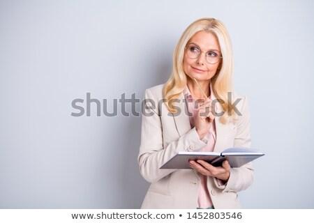 Maturité femme d'affaires regarder l'ordre du jour téléphone téléphone Photo stock © photography33