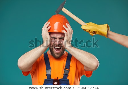 laborer hitting his head with hammer stock photo © photography33