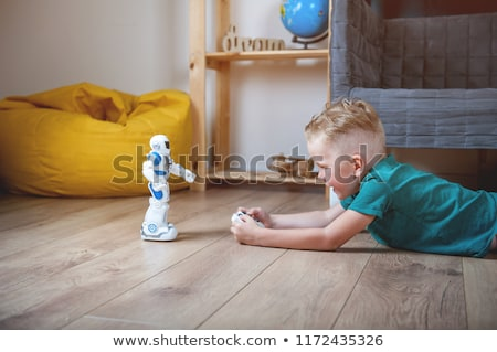 Young girl playing with a remote-control car Stock photo © photography33